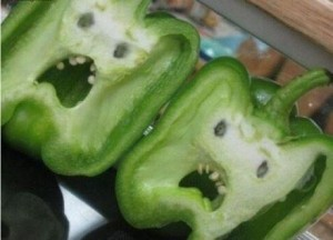 photo of green peppers with screaming faces