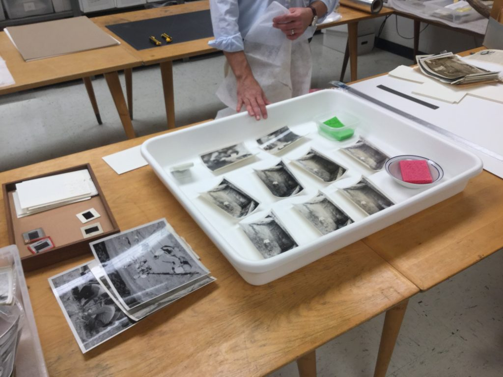 Teaching humidification and pressing of photographs to Archaeology students and staff