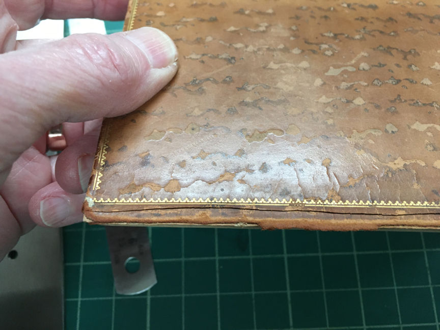 Front cover showing the beveled cut first made in the leather.