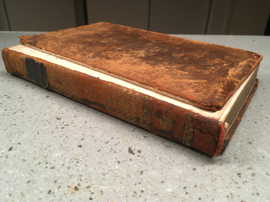 A leather-bound book with detached front cover.