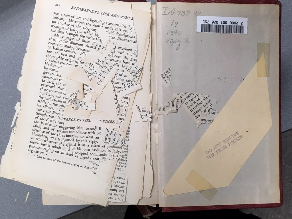 Book with brittle paper, with pages broken into little bits.