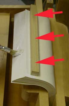 Glue being applied to a double-fan adhesive binding.