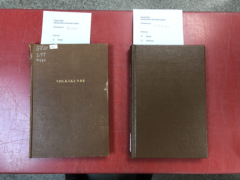 Two copies of the same book, closed