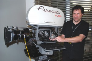 Everett with Panavision 65mm Camera and holding an Eric Berndt 3mm Camera (image courtesy of AMPAS Sci-Tech Council Historical Subcommittee)