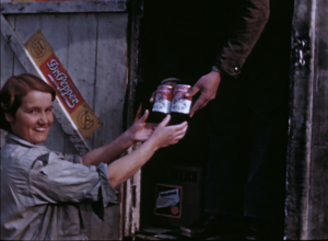 """Still from You Can't Eat Tobacco. Canned milk is purchased from the """"rolling store."""""""