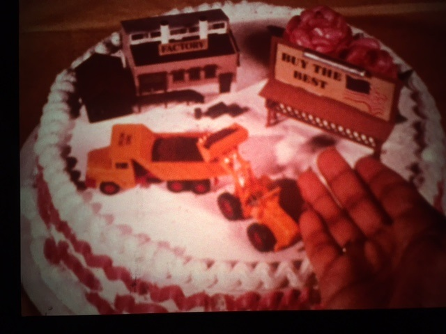 "The jury's still out on whether Jeffrey's girlfriend appreciates the dump truck on her birthday cake, but she should be proud of her boyfriend for getting the best deals and learning how to shop wisely! (from: ""Product Costs: What's In Them?"" [1979])."