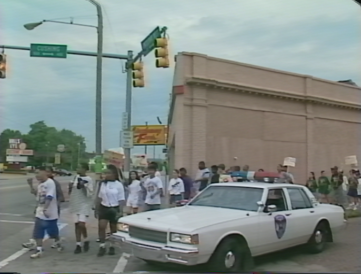 A screen grab of a WSJV segment on student demonstrations in South Bend, Indiana. July 26, 1995.