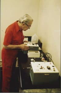 Borkenstein examining a Breathalyzer Model 900B, manufactured by the Drager Corporation, circa 1985-1995.