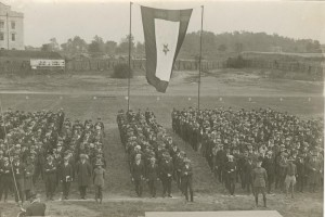 Recruits and service flag during induction ceremony, 1918.