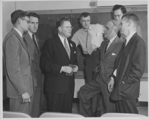 Dr. Marvin Carmack (third from left) talks with other chemists after delivering a lecture at du Pont Laboratories (1952).