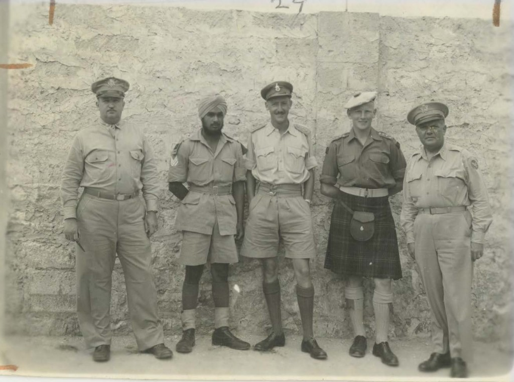 """Harry Hanna, Class of 1926, served in the Air Service Command. Here he poses with other members of the Allied troops. In a memo encouraging the use of this photo in the Alumni Magazine, President Herman B Wells commented that """"it certainly illustrates the cosmopolitan character of our Allies."""""""
