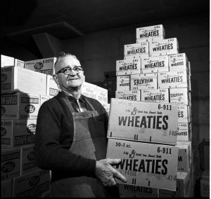 IU employee with boxes of Wheaties cereal, December 10, 1964
