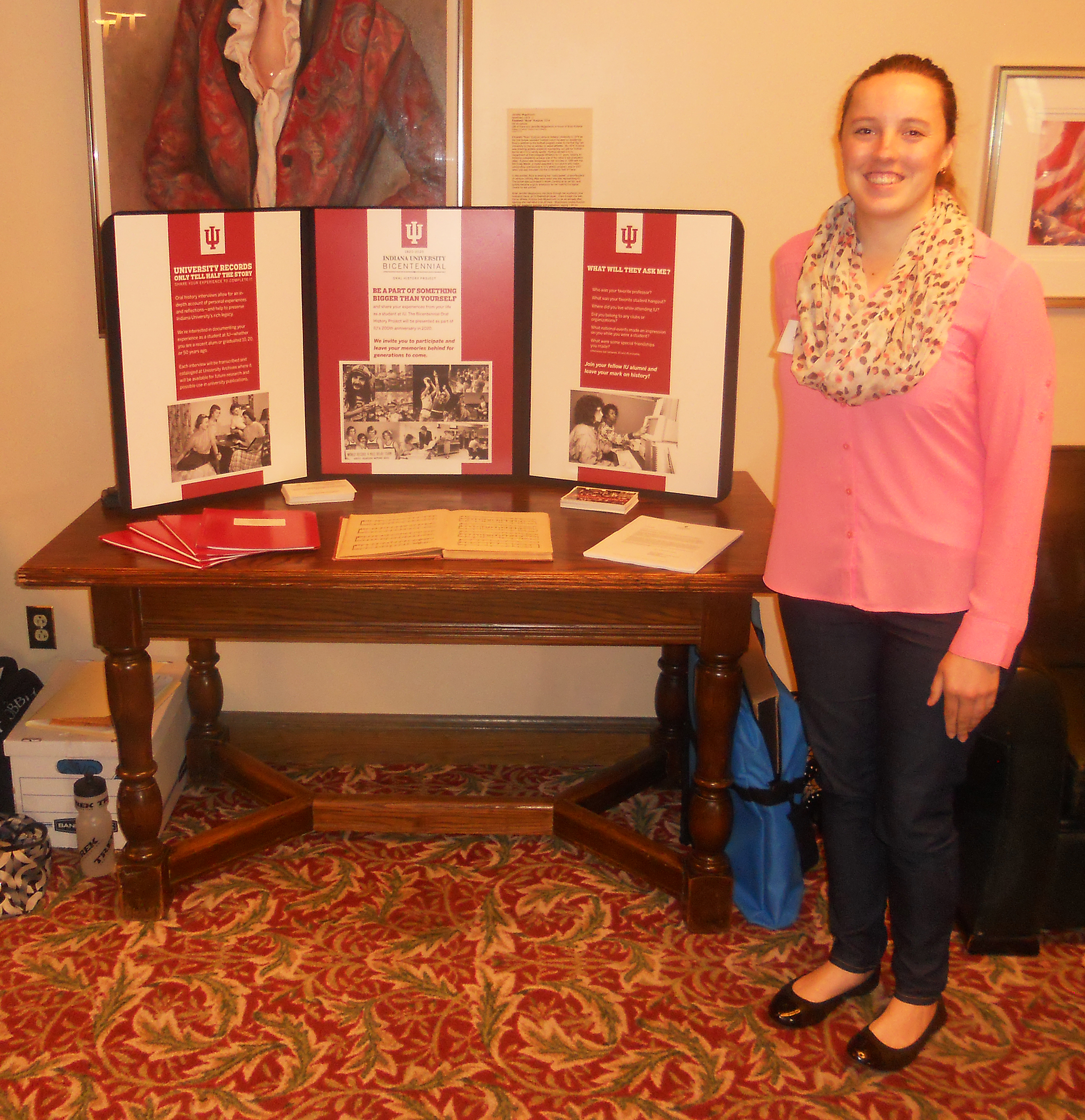 Katie manning the Oral History booth at Cream & Crimson Weekend.