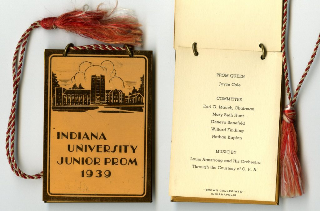 This dance card from May 5, 1939 has a metal casing and shows Louis Armstrong performed at the dance sponsored by The 1939 Junior Class of IU.