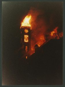 The Student Building's clock and bell tower ablaze on Dec. 17, 1990.