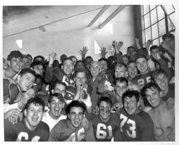 1945 football team in locker room after beating Purdue