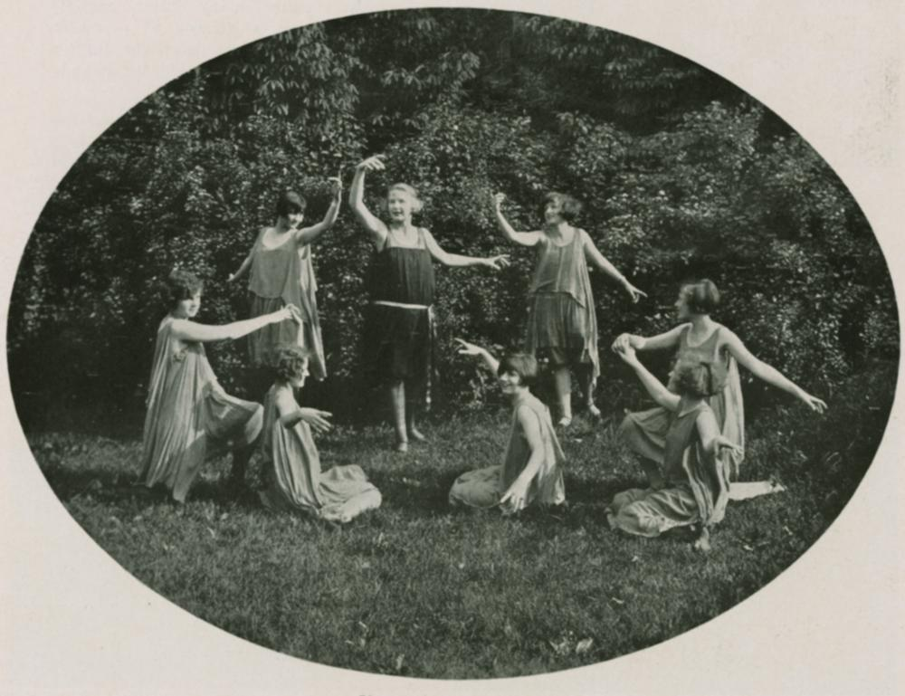 A scene from the 1924 May Festival, IU Archives photograph. Eight women dance in a field.