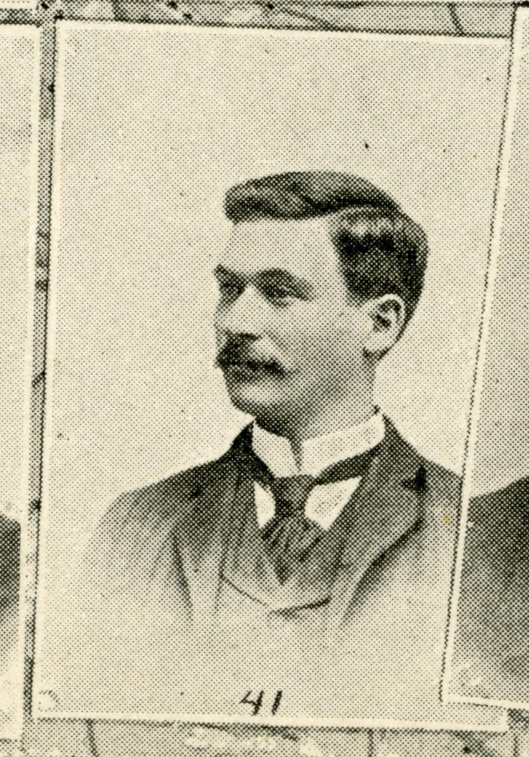 Black and white scan from the IU Arbutus yearbook. Image shows a man with dark hair and mustache wearing a suit and tie.
