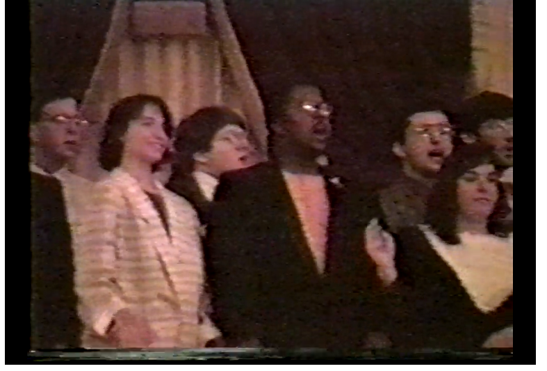 Attendees at APO gathering in Boston sing the organization's song, 1985.