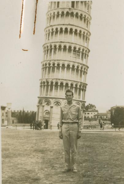 Charles Baker in front of the Leaning Tower of Pisa