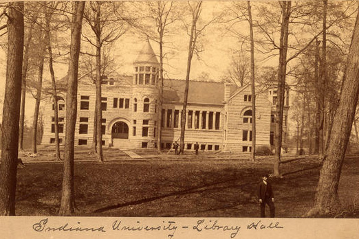 Sepia tone photograph of Maxwell Hall through the trees of Dunn's Woods