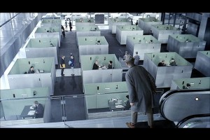 group of cubicles with a man looking down at them
