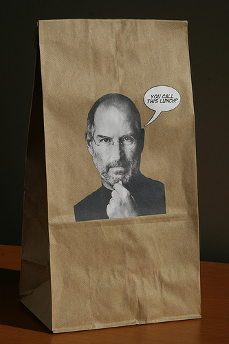 brown bag with Steve Jobs' photo on it