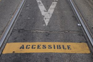 """Accessible"" painted on pavement"