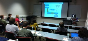 Image 3: Graduate students listen to Dean David W. Lewis's lecture on Open Access at Thursday's brown bag event