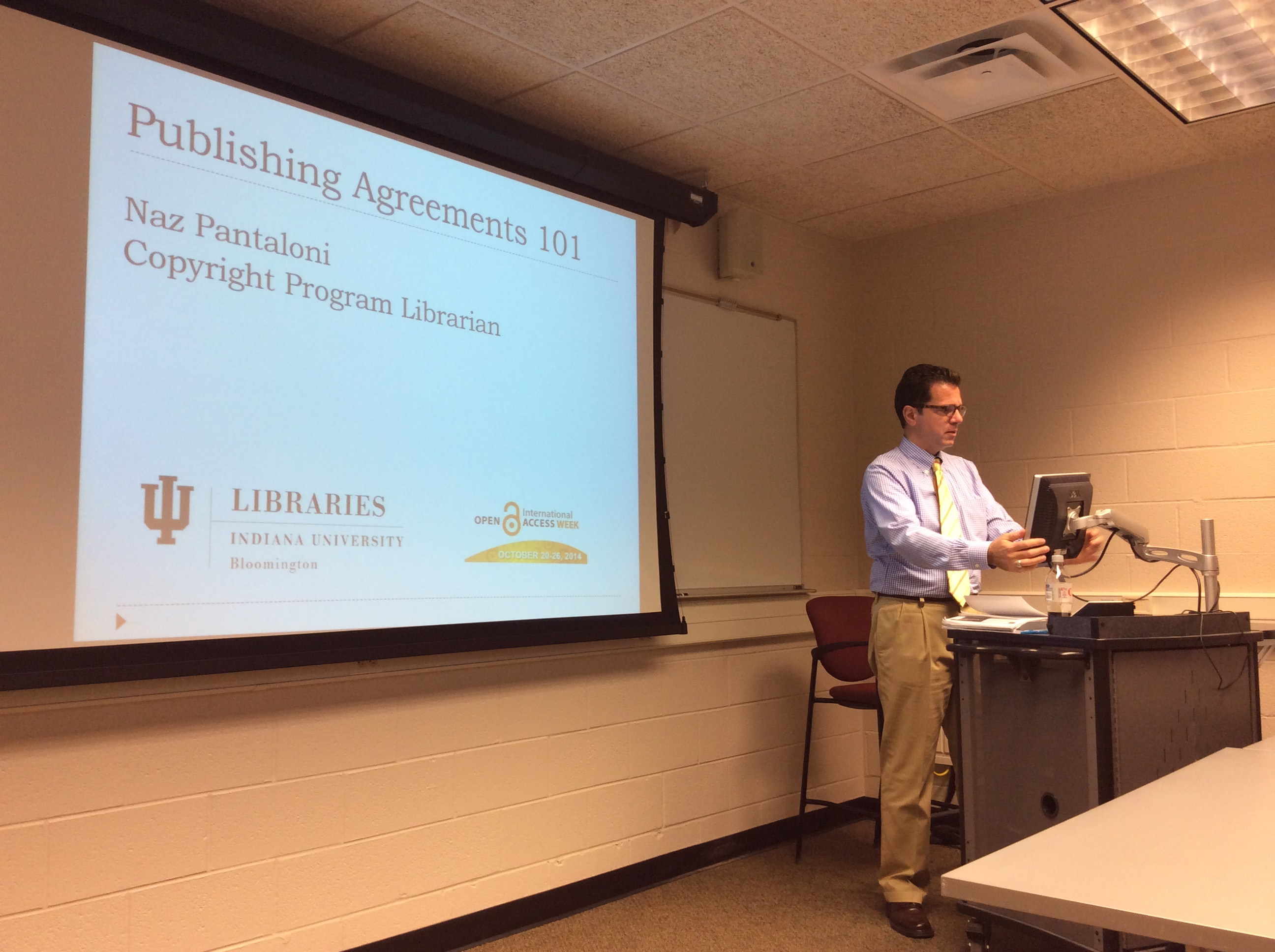 Naz Pantaloni gears up for his presentation on journal publishing agreements.