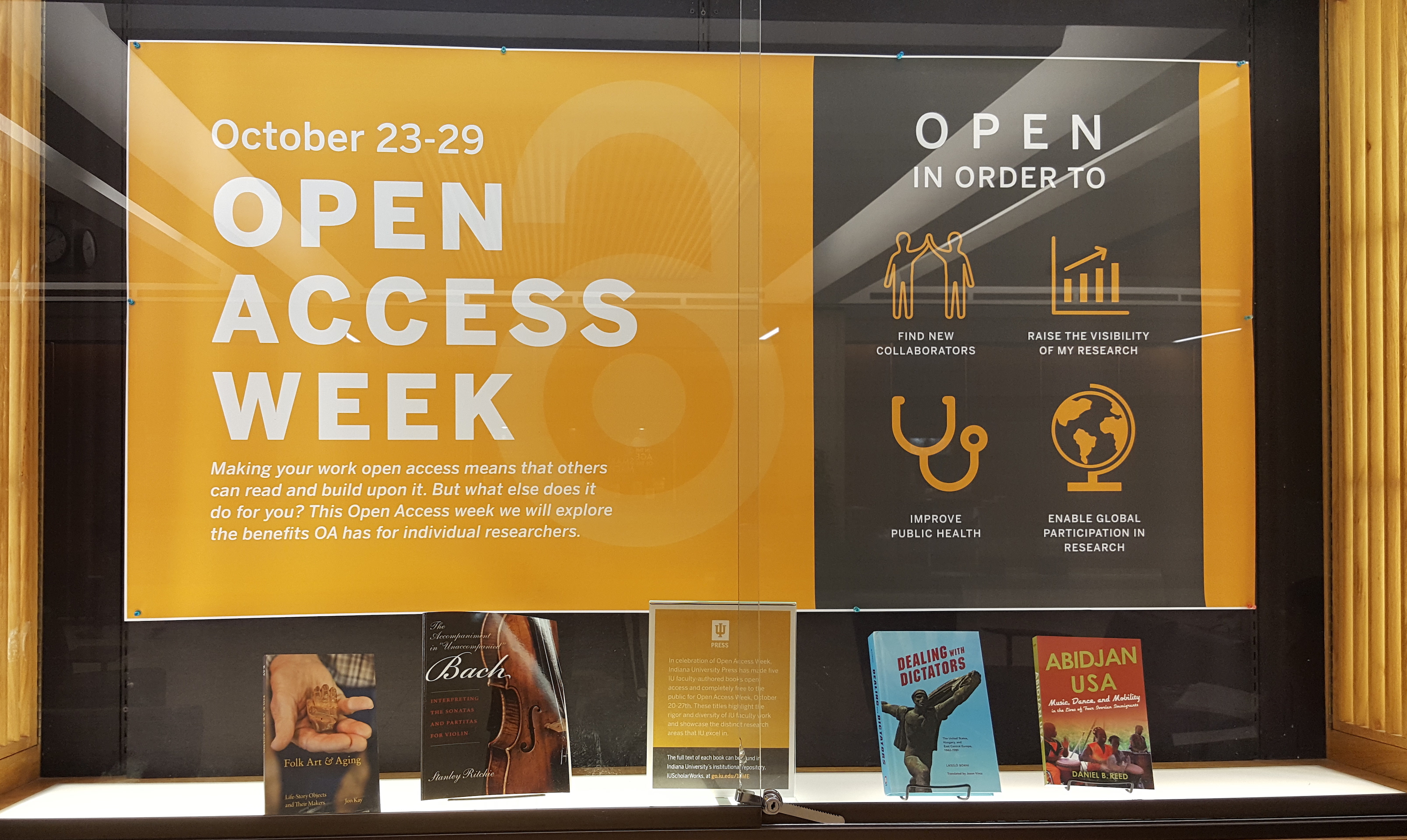 OA week display case with open press books