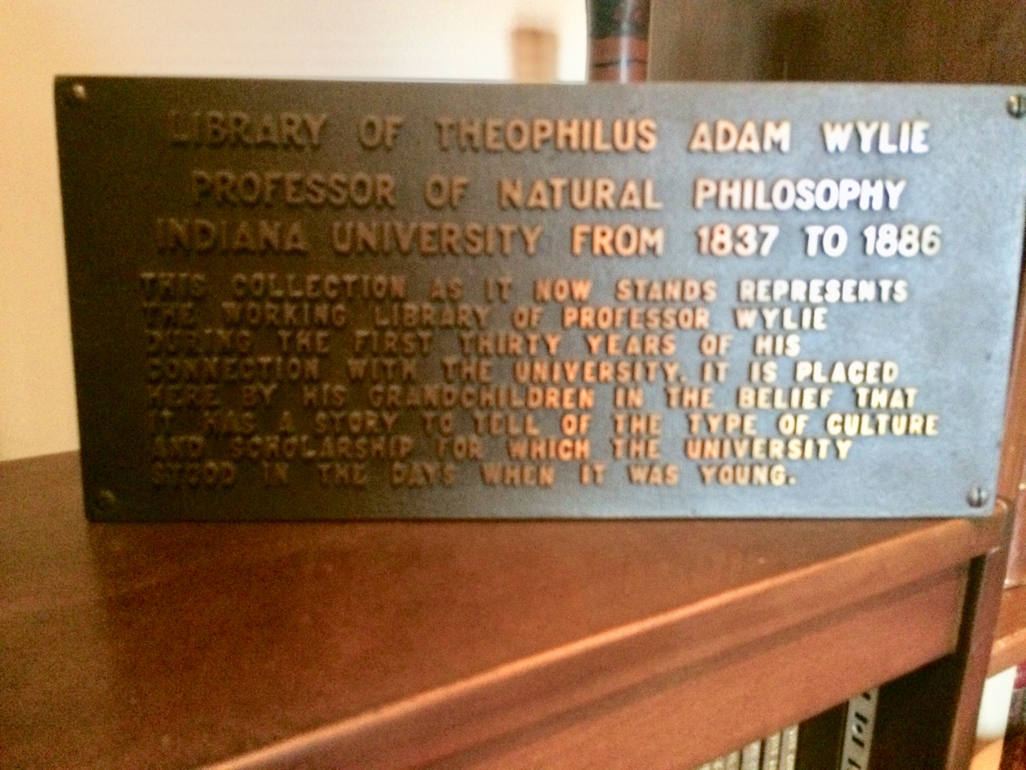"plaque stating ""library of Theophilus Adam Wylie Professor of Natural Philosophy Indiana University from 1837 to 1886"